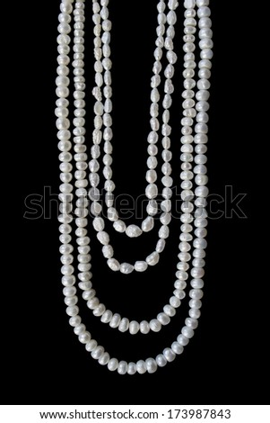 Pearl vintage necklace of four strings isolated over black - stock photo