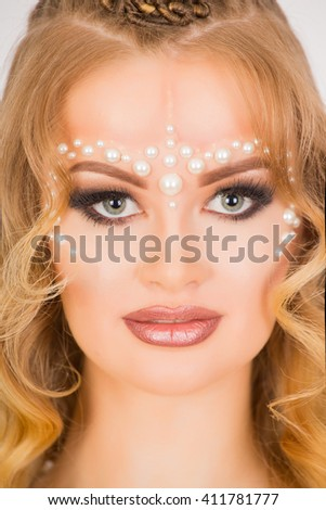 Pearls accessories on the face  - stock photo