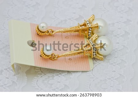 pearls earrings on white isolated background - stock photo