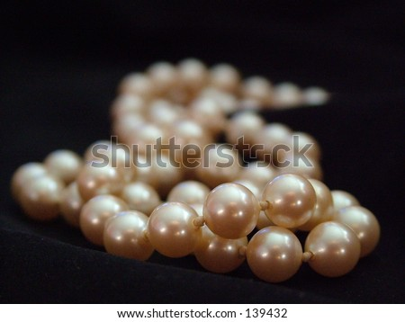 Pearls on Black fabric - stock photo