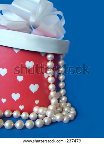 Pearls spilling out of heart box - stock photo