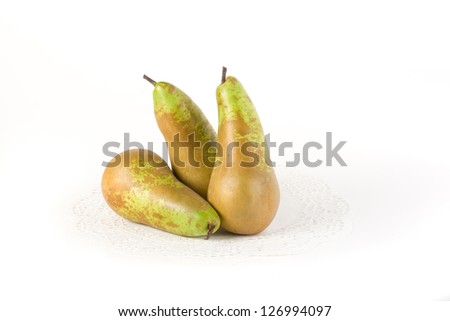 Pears. One sliced pear slices, another whole. Isolated on white background - stock photo