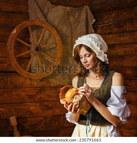 Peasant Woman cook a festive meal to the day of harvest. Retro stylized image. - stock photo