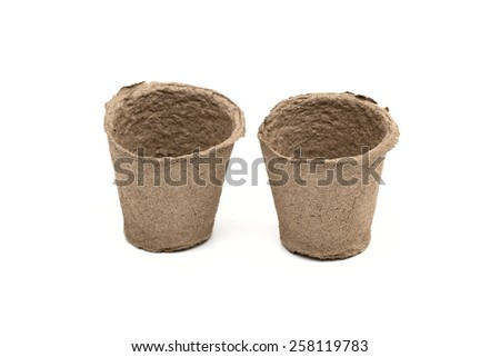 peat pot on the white background - stock photo