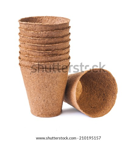 Peat pots isolated over white - stock photo