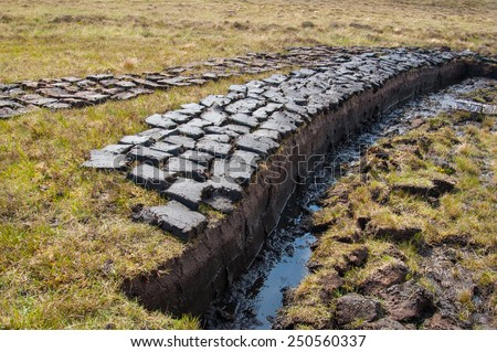Peat (turf) cut and left to dry on a wetland in the Scottish Highlands - stock photo