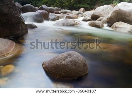 pebbl es or rocks in creek or stream flowing water - stock photo