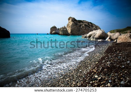 Pebble beach and blue sea in the Aphrodites birthplace. Paphos, Cyprus. Toned. - stock photo