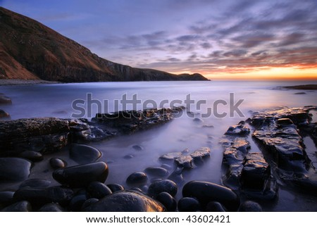 pebble beach on the wild cost south Africa - stock photo