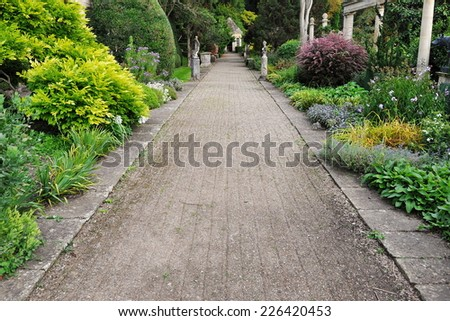Pebble Path in a Beautiful Garden - stock photo