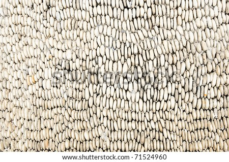 Pebble patterns on the walls of the resort - stock photo