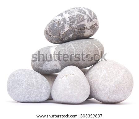 pebble pile isolated on white background - stock photo