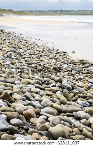 pebbled ballybunion beach beside the links golf course in county kerry ireland - stock photo