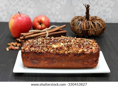 Pecan, cinnamon and apple loaf cake, homemade. - stock photo