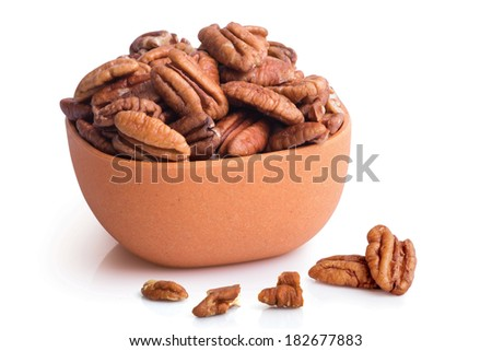 Pecan nuts in a bowl - Nuts series - stock photo