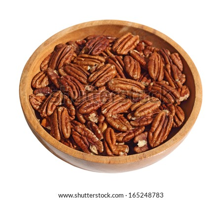 Pecan nuts in wooden bow isolated on white - stock photo