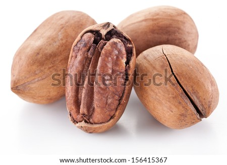 Pecan nuts isolated on a white background. - stock photo
