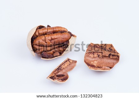 pecan nuts isolated on white - stock photo