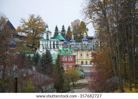 PECHERY, RUSSIA - OCTOBER 19, 2014: Cloudy October day in the Pskov-Pechora monastery - stock photo