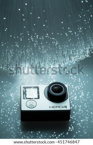 Pecs, Hungary - July 10, 2016: GoPro Hero 4 on fiber optical background. It is a compact, lightweight personal camera manufactured by GoPro Inc. - stock photo
