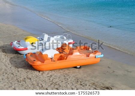 Pedal boats for rent on the blue sea line and clear blue sky/Pedal boats  - stock photo