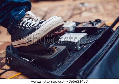 Pedal guitarist - stock photo
