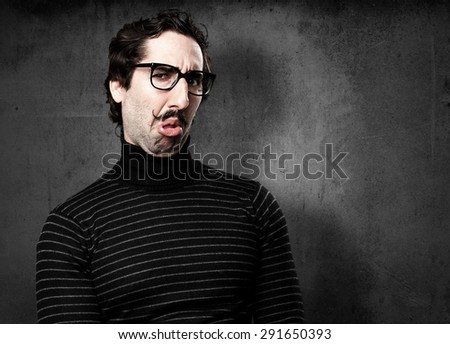 pedantic man disgust face - stock photo