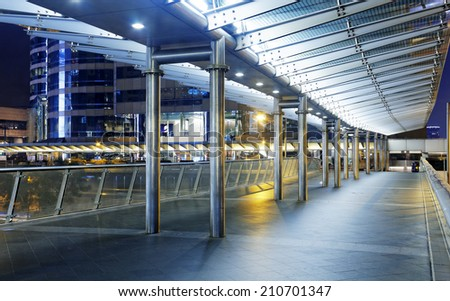 Pedestrian bridge at night in hong kong central - stock photo