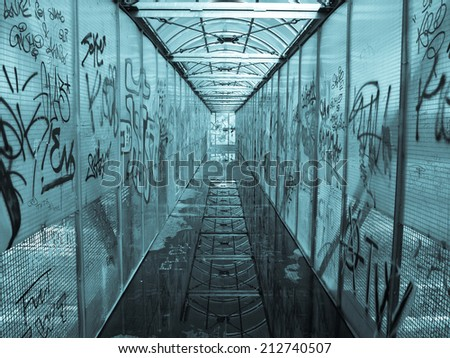 Pedestrian bridge with graffiti picture - cool cyanotype - stock photo