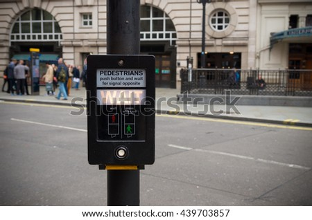 pedestrian button saying Wait in London, england - stock photo