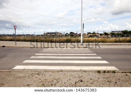 Pedestrian crossing in abandoned housing estate building site, Valencia region, Spain - stock photo
