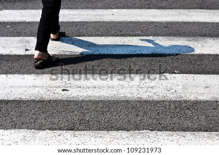 Pedestrian crossing  in back light - stock photo