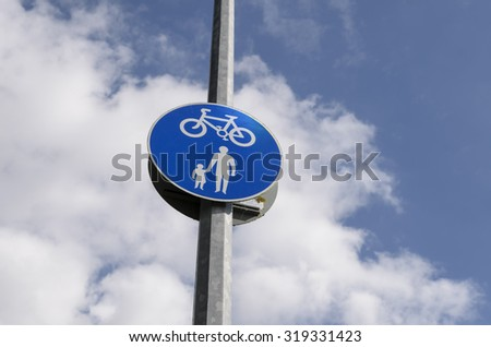 Pedestrian crossing. Modern  road sign above blue sky background - stock photo