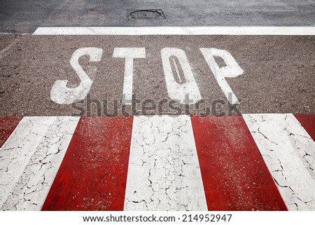 Pedestrian crossing road marking with stop line - stock photo