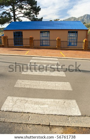 Pedestrian crossing to a small school in a township in South Africa - stock photo