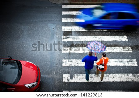 pedestrian crossing with car - stock photo