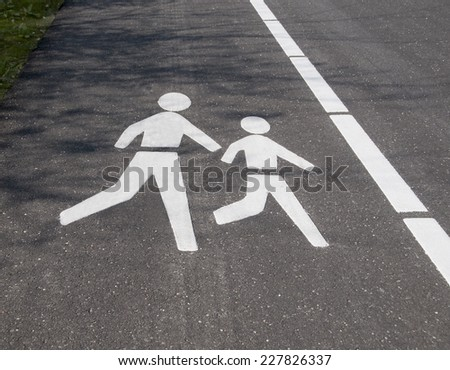 Pedestrian logo in perspective on a road - stock photo