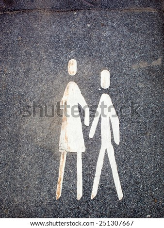 Pedestrian sign painted on a pavement - stock photo