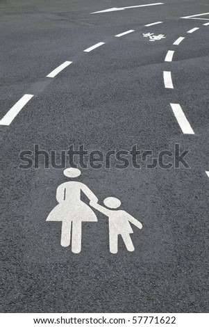 pedestrian sign ( parental guidance ) on the parking area. - stock photo