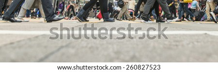 pedestrian walking on the streets of Hong kong - stock photo