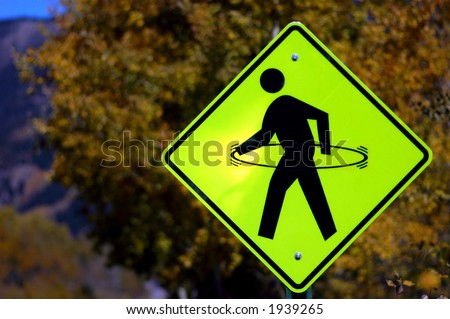 pedestrian warning sign with hula-hoop modification - stock photo