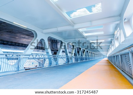 Pedestrians and non-motorized vehicle travel modern bridge - stock photo