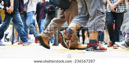 Pedestrians crossing a street. Urban rush hour  - stock photo