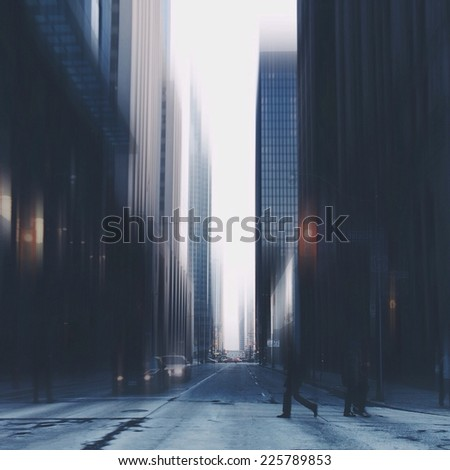 Pedestrians crossing the street in a large city of tall buildings. - stock photo