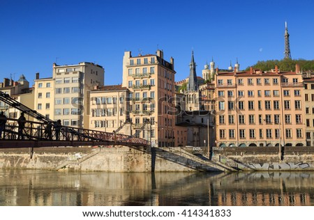 Pedestrians on the Passerelle Saint-Vincent over the Saone river in Lyon city. - stock photo