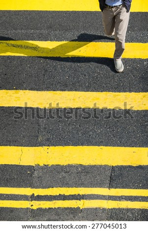Pedestrians people moving at zebra crosswalk. Hong Kong. Crowded city abstract background - stock photo