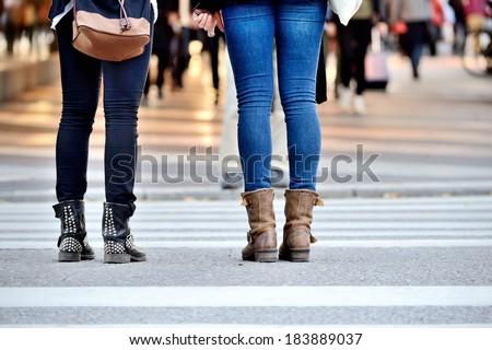 Pedestrians waiting to cross street - stock photo