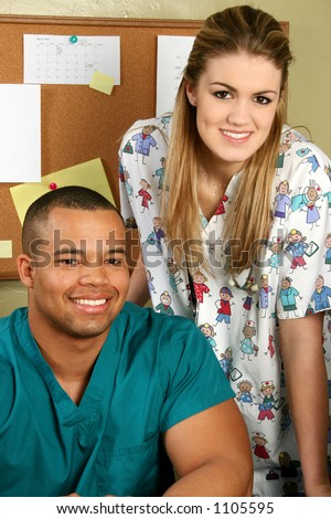 Pediatric doctor and friendly nurse with stethoscope. Shot with a Cannon 20D. - stock photo