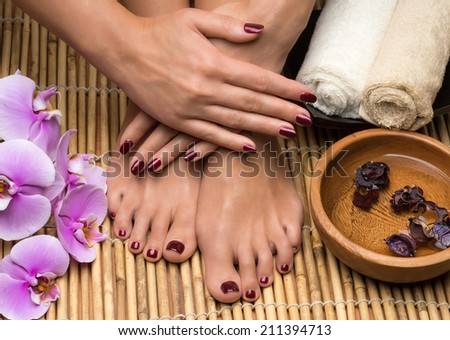 Pedicure and manicure in the salon spa - stock photo