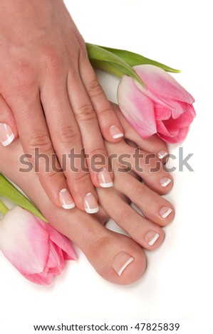 Pedicured feet in an Easter spa - stock photo